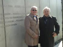 Standing next to the memorial